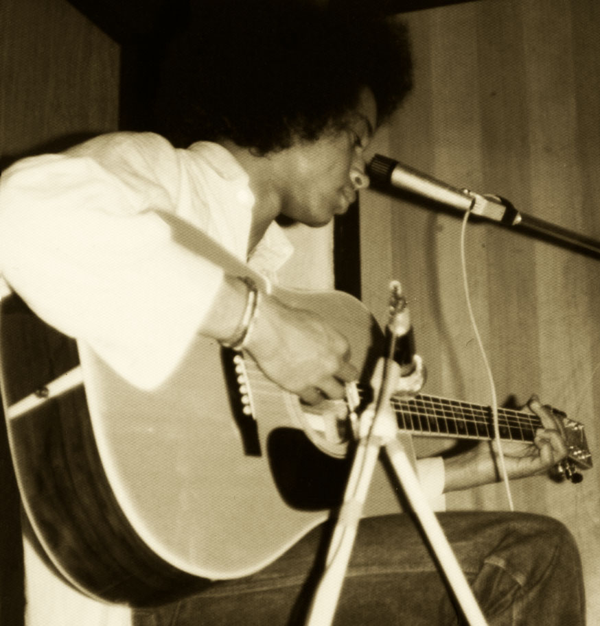 Erik Playing Acoustic Guitar a long time ago