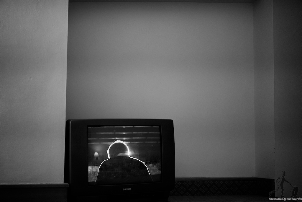 Man on TV screen in Accra guest house by Erik Knudsen