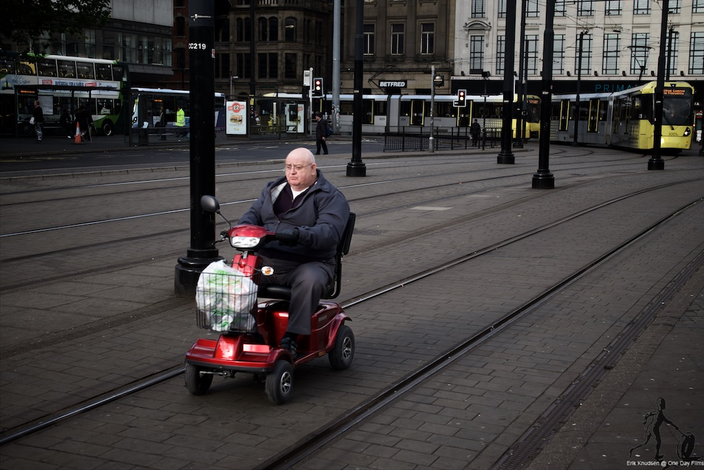 Mobility Scooter Rider Beats The Tram by Erik Knudsen