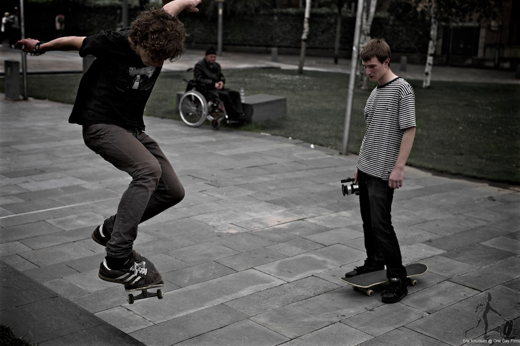 Skateboarders and disabled man by Erik Knudsen