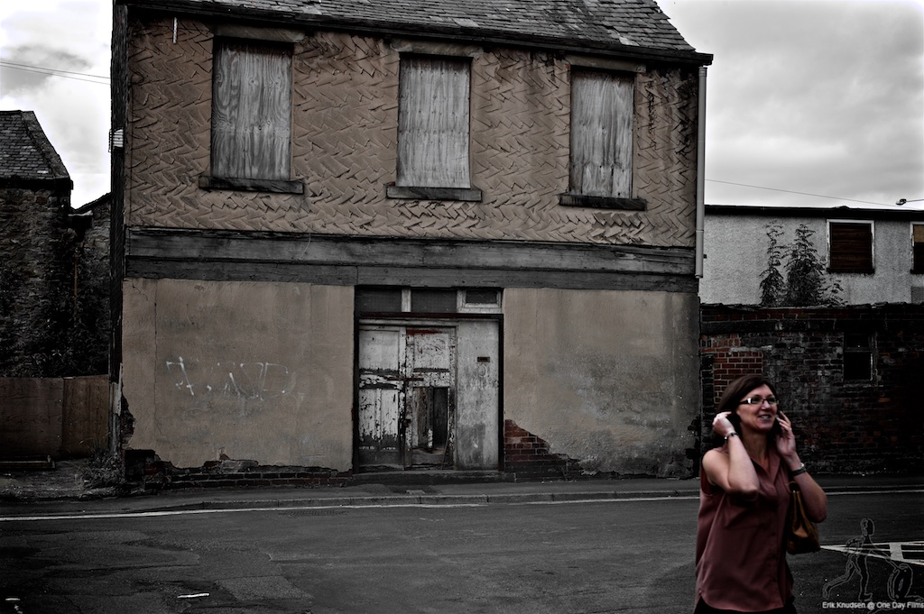 Woman by derelict house in Burnley by Erik Knudsen